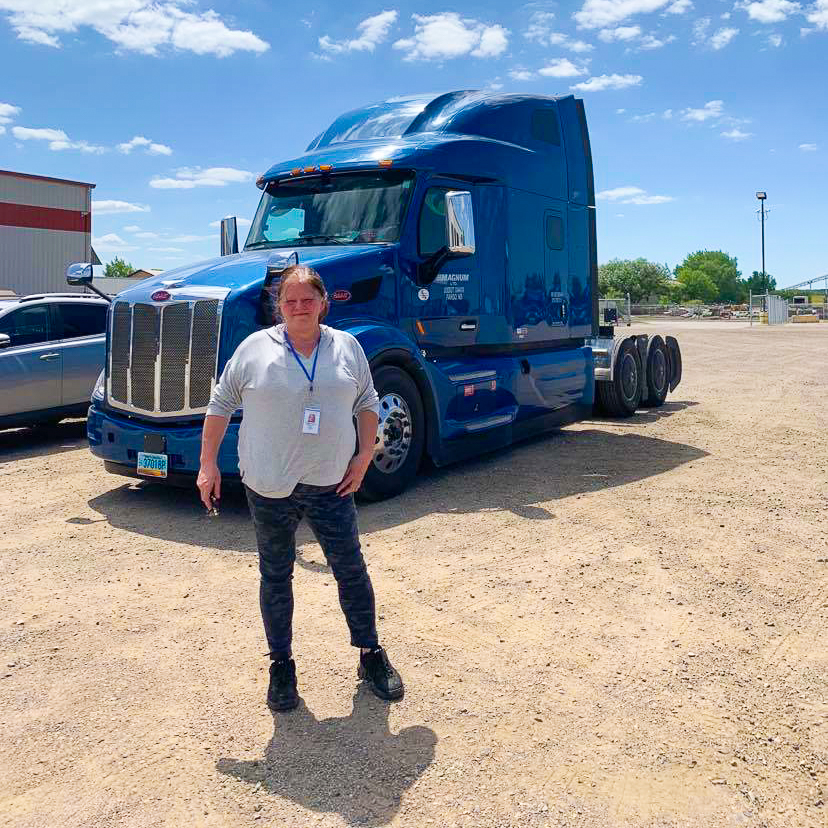Heather PTR Driver in front of OTR Truck