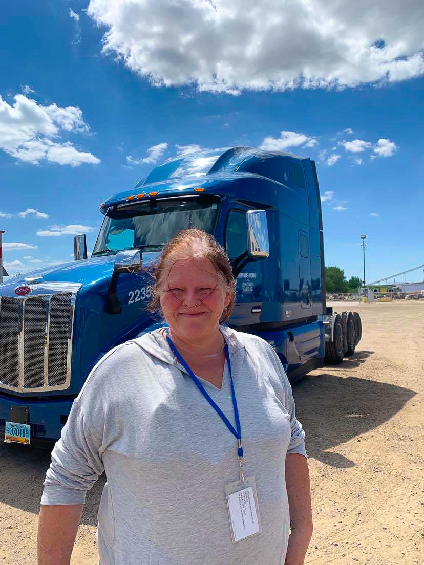 OTR Driver Heather Werner in front of Magnum truck