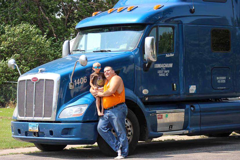 OTR Driver Adam in front of Truck